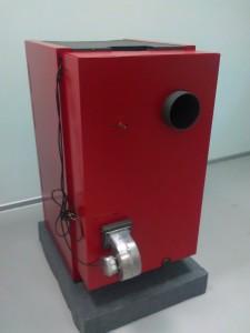 Baksida G-18E - G-40E. rökrörsstos, luftfördelningsspjäll och förbränningsfläkt samt
